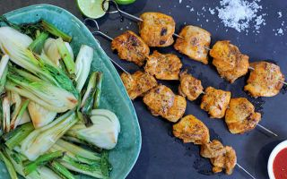 Photo: Sriracha and lime chicken kebabs with pak choi